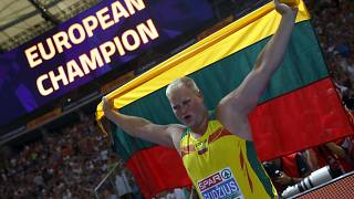 Andrius Gudžius of Lithuania celebrates winning a gold medal