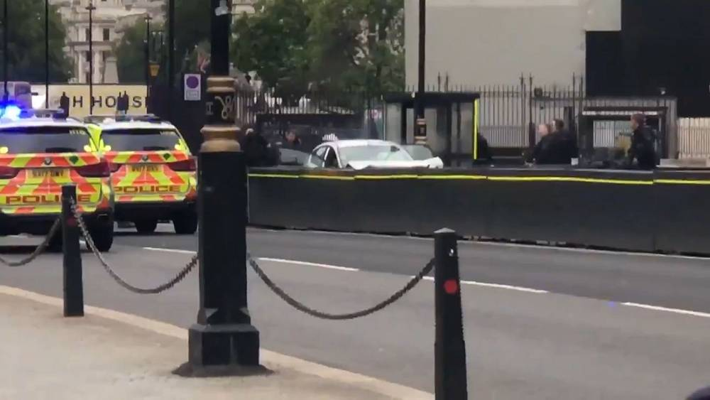 Car smashes into barriers outside UK parliament