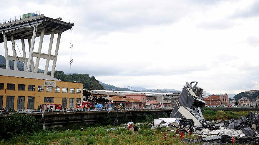 Rescue workers are seen at the collapsed Morandi Bridge near Genoa, Italy