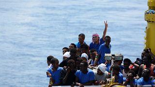 Migrants rest on board migrant rescue ship Aquarius