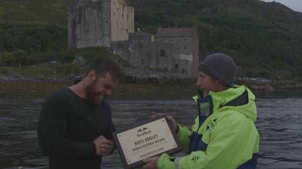 Watch: British swimmer breaks world record for longest staged sea swim