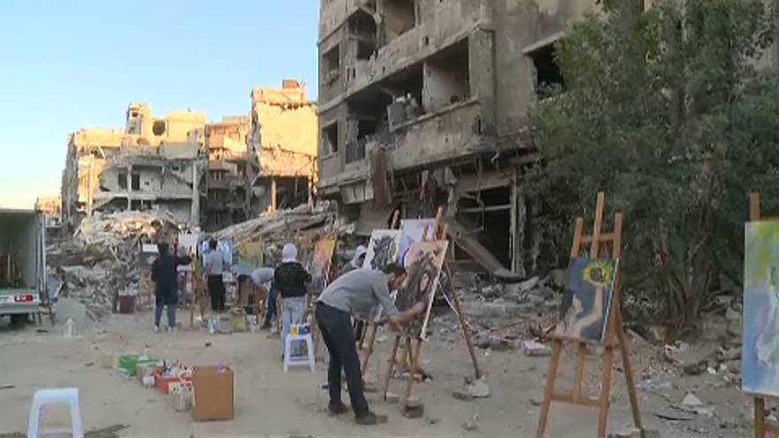Refugee artists return to Yarmouk camp in Syria to paint dreams