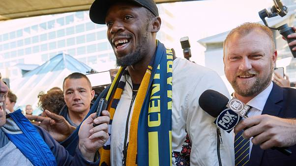 Usain Bolt touches down for his Australian football experience