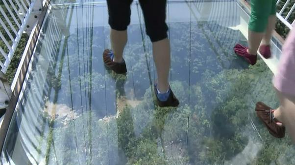 China's longest glass-bottom suspension bridge makes its debut