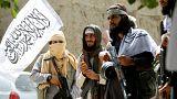 Taliban walk as they celebrate ceasefire in Ghanikhel district of Nangarha