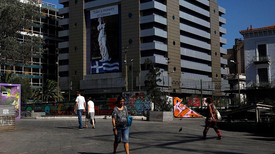 Atenas recebe o fim do resgate sem ilusões