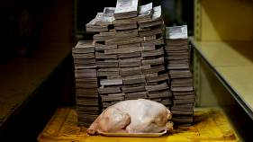 These photos reveal the huge amounts of cash Venezuelans need to buy daily essentials