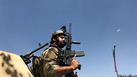 Member of the Afghan security forces keeps watch at the site of th attack