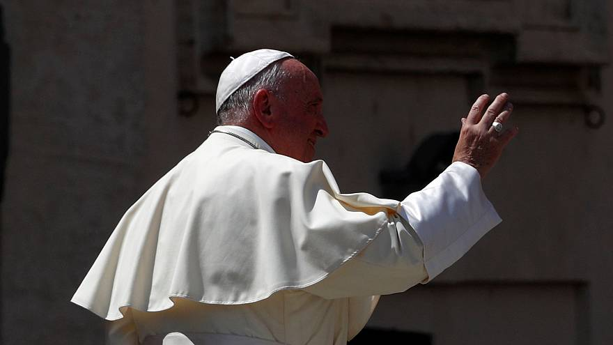 Pope Francis waves in St. Peter's square at the Vatican