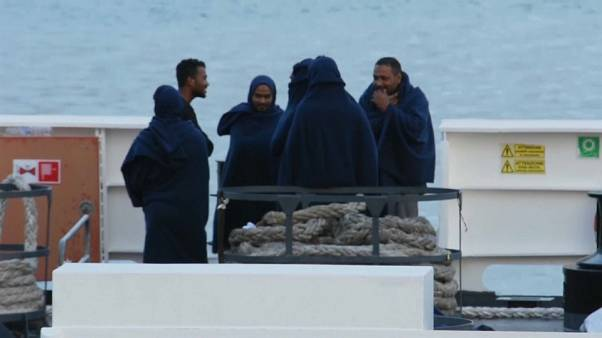 Migrants on board Italian coastguard ship docked in Catania, Sicily