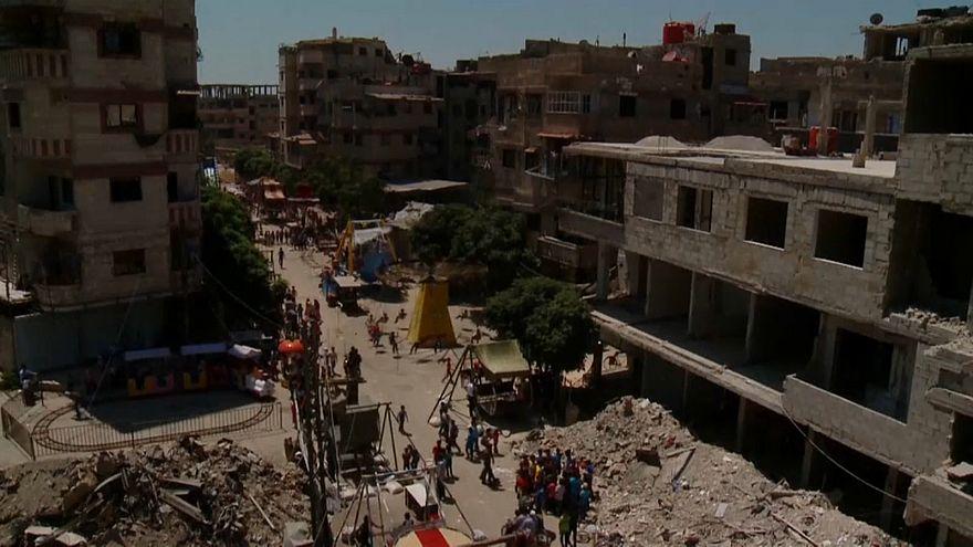Ugrálóvár a romok között – áldozati ünnep Szíriában