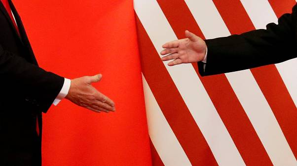 U.S. President Donald Trump and China's President Xi Jinping shake hands
