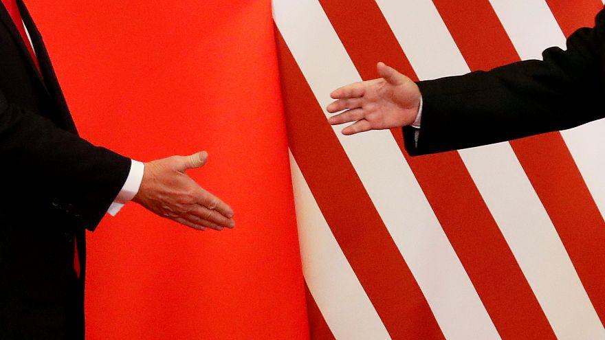 U.S. President Donald Trump and China's President Xi Jinping shake hands