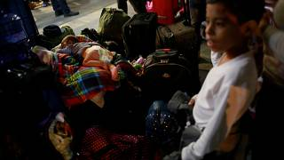 Venezuelan migrants arrive at the Binational Border Service Center of Peru,