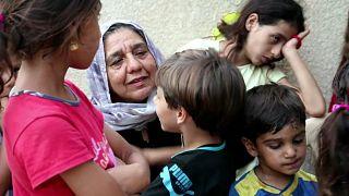 Iraquiana toma conta de 22 netos órfãos