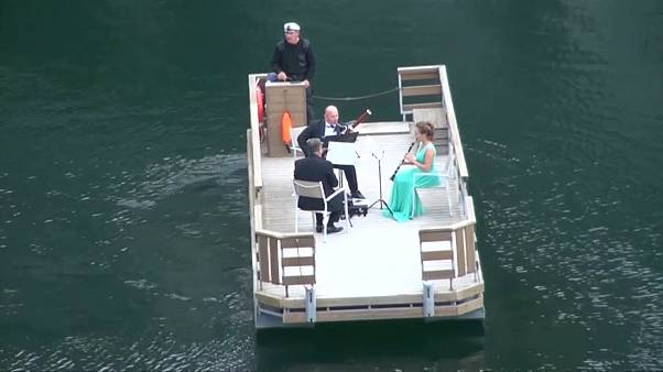 Watch: Orchestra players perform on water
