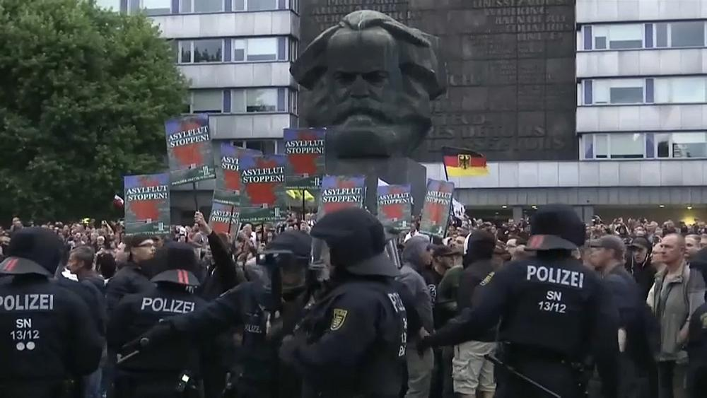 Several injured as rival protesters clash in Germany