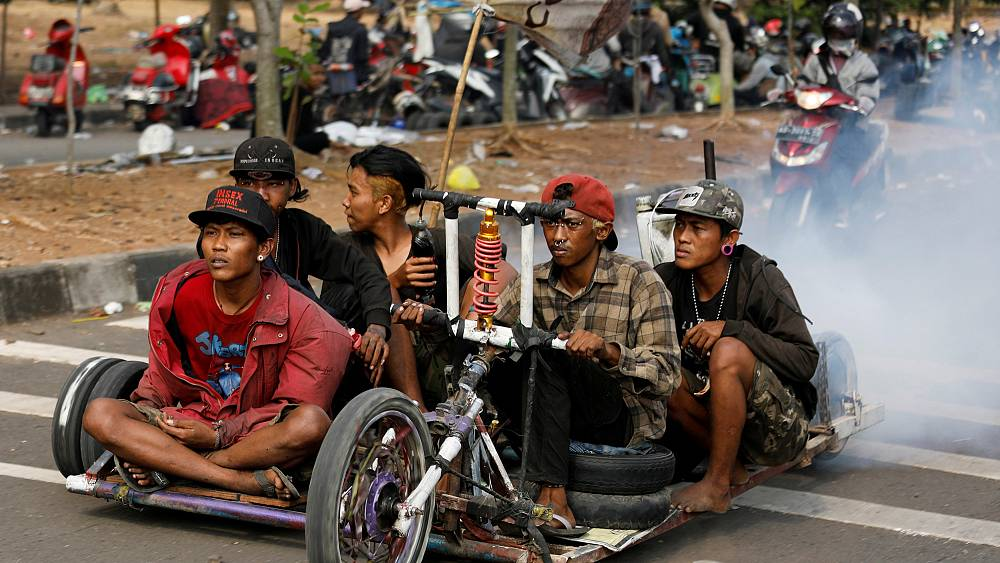 Watch: Crowds gather in Indonesia to celebrate classic Vespa scooter