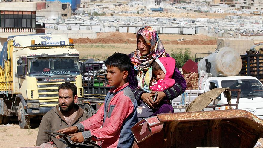 A Syrian family prepares to return to Syria from Lebanese border town