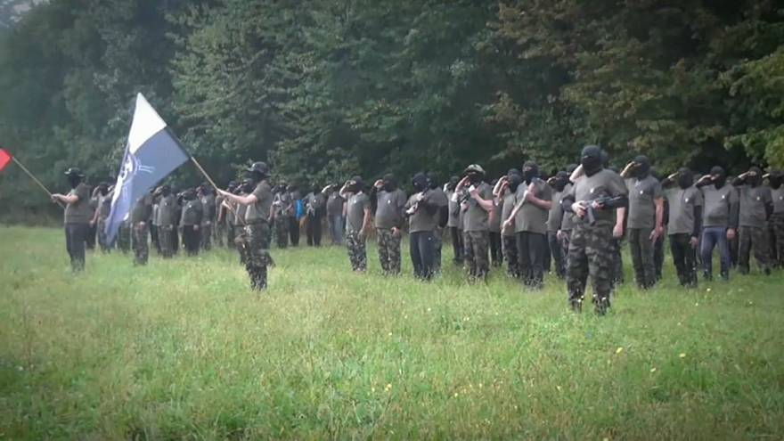 Watch: Masked armed group in Slovenia pledges to 'secure order if necessary'