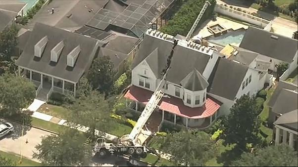 Crane falls onto Orlando home, slicing roof