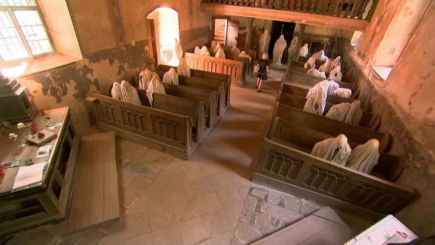 Haunting memory - tourists flock to ghostly church