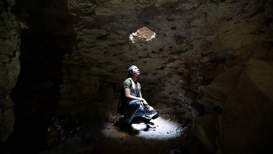 A man takes shelter in an underground cave in Idlib, Syria