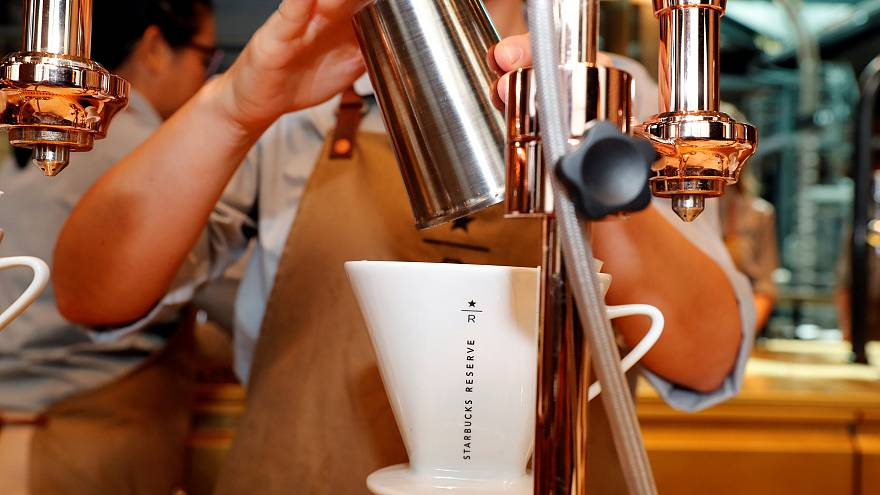 An employee prepares coffee at the new Starbucks Reserve location in Milan