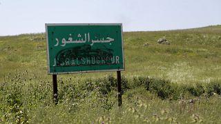 لافتة من منطقة جسر الشغور في إدلب
