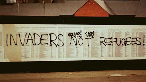 'Invaders not refugees': UK migrant memorial defaced again