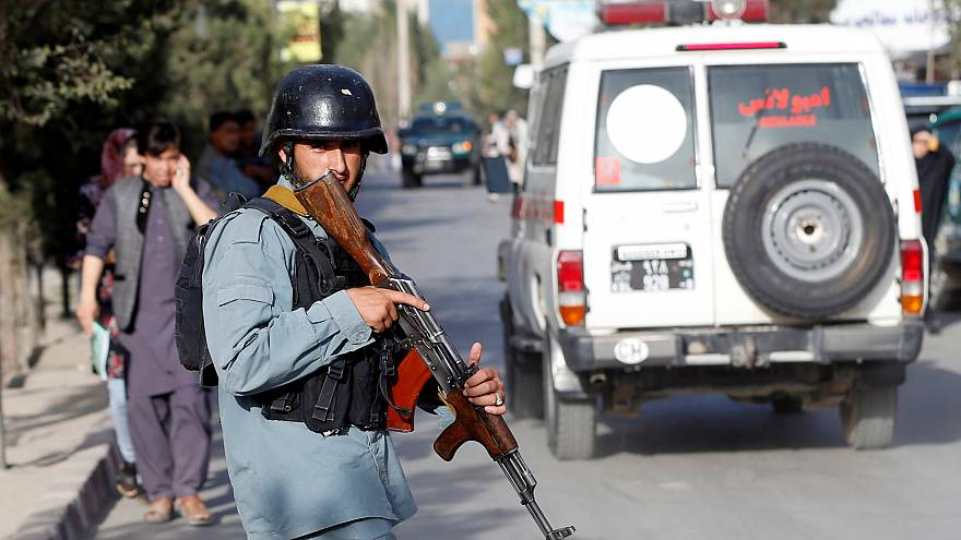 An Afghan policeman near the site of a suicide bomb blast in Kabul.