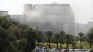 Smoke rises form the headquarters of Libyan state oil firm NOC