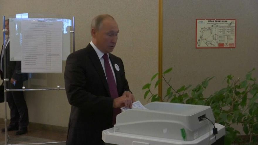 Watch: Putin squirms as voting machine rejects his ballot