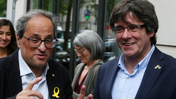 Separatist Catalan leader Quim Torra and his predecessor Carles Puigdemont