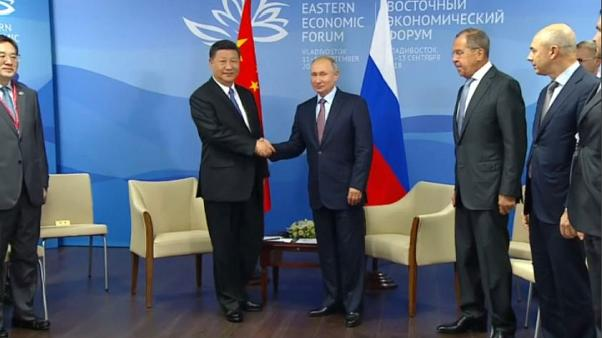 China urges Russia to work to oppose protectionism