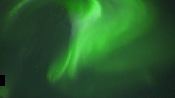 Northern Light display illuminates sky over Arctic Circle