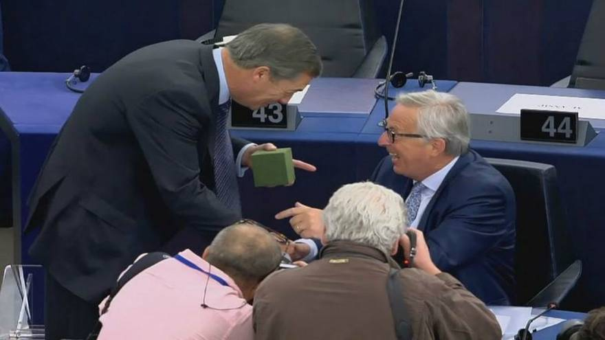 Sock it to him: Farage presents Juncker with gift at State of the Union