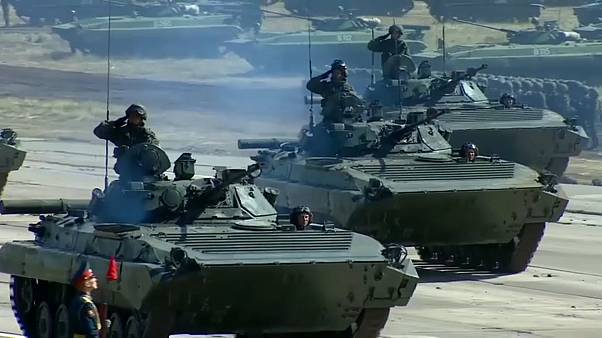 Putin claims no aggressive intent as war games end