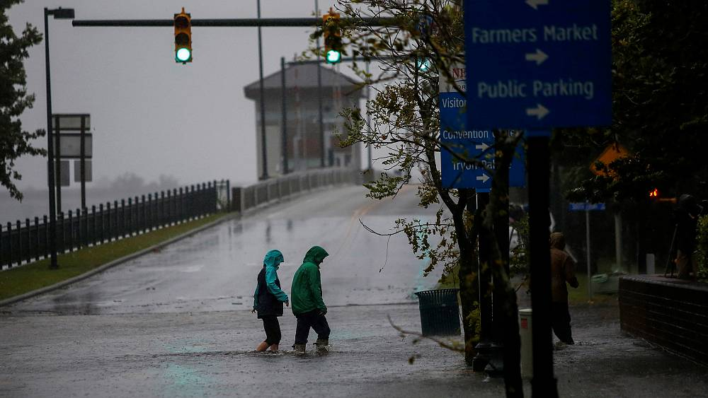 Five dead in tropical storm as flooding and surges continue on US East Coast