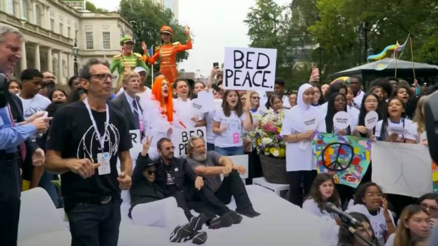 Students get perfect mix of bed and protest in Lennon-inspired NYC event
