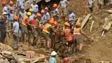 rescue workers dig for bodies after a landslide in northern Philippines