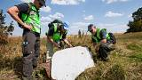 Dutch and Australian officers inspect the site of the MH17 crash.
