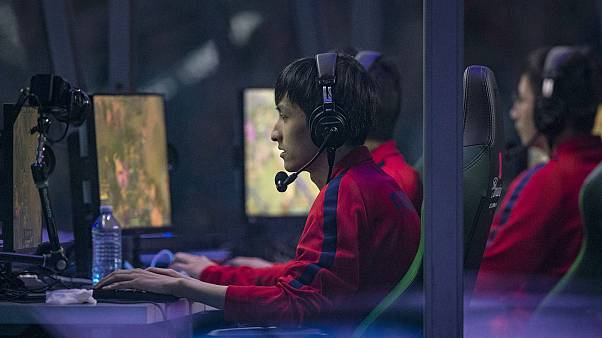 "Team LGD plays ""Team Evil Geniuses"" at an eSports tournament in Vancouver"