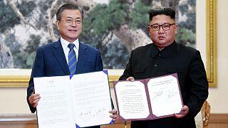 Moon Jae-in shakes hands with North Korean leader Kim Jong Un