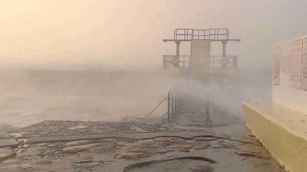 Woman dies as caravan blown onto beach by Storm Ali