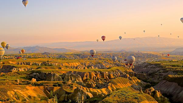 Tourists return to take flight in hot air balloons in Cappadocia, Turkey