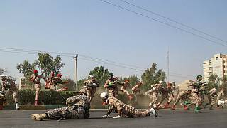 گزارش تصویری از حمله افراد مسلح به مراسم رژه در اهواز