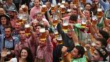 Visitors cheer during the opening day of the 185th Oktoberfest in Munich