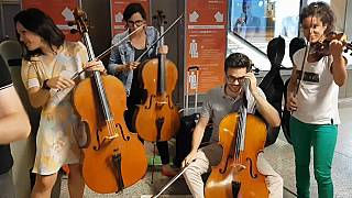 Passengers delayed at Geneva airport treated to impromptu concert