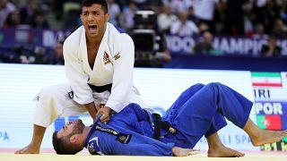 Saeid Mollaei of Iran in action against Anri Egutidze (blue) of Portugal